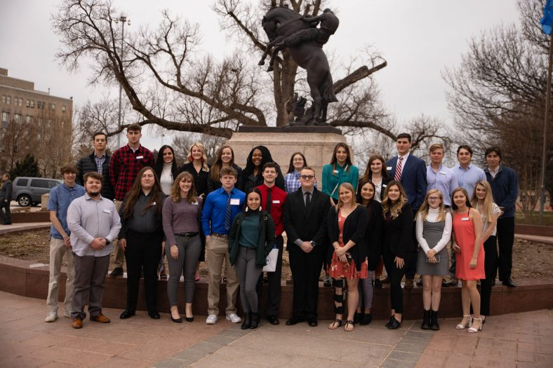 """SSC students gather for a group photo in front of the State Capitol following Feb. 11's """"Higher Ed Day"""" program."""
