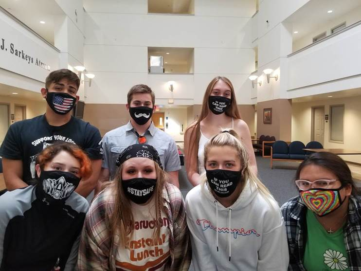 Resident Assistants wear silly masks.
