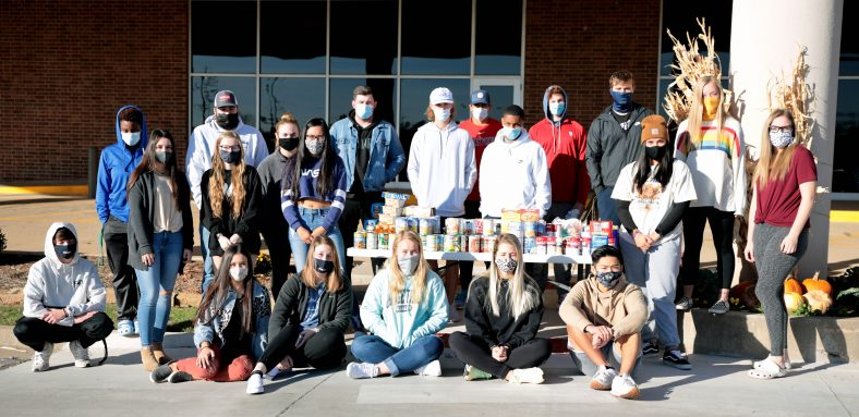 Leadership class stands with their donations.