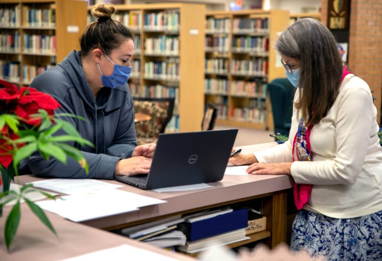 SSC Student Lacy Fisher (left) is assisted by Librarian Robin Tyler (right)