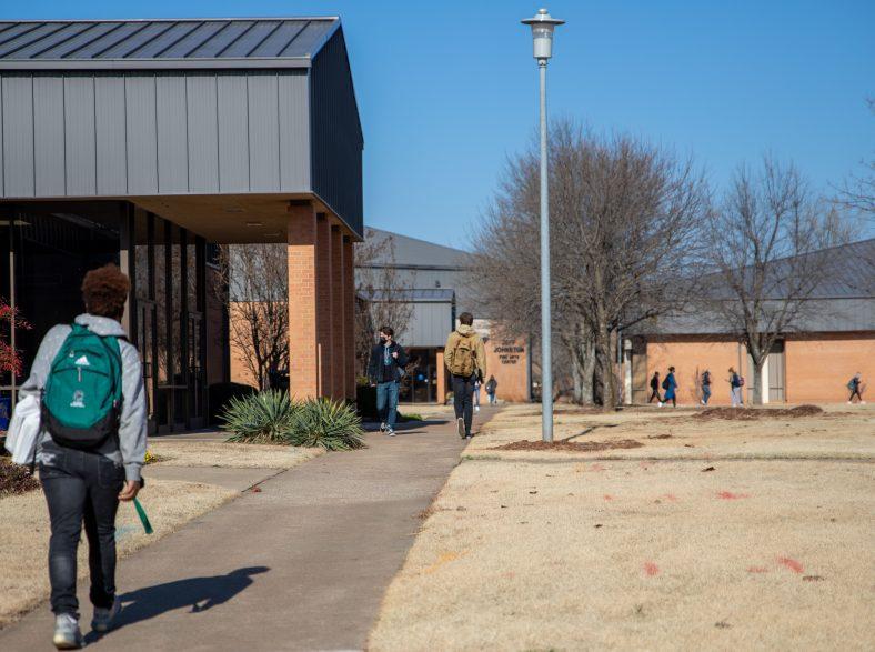 Students walking on the sidewalk between classes