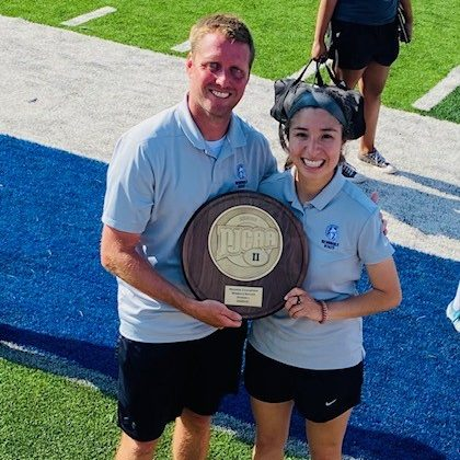 Trojans soccer Head Coach Dan Hill (left) and Assistant Coach Chely Flores (right) celebrate after the team won the Region II Tournament last month. Hill was named the 2021 Region II Women's Soccer Coach of the Year.