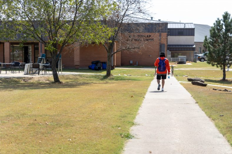 An SSC student walks through the courtyard on campus.