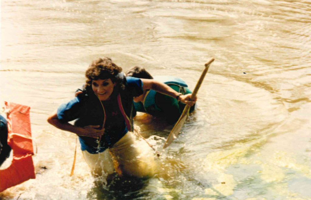 After an unsuccessful canoe race, former business office cashier Carolyn Simmons surfaces from the campus pond.