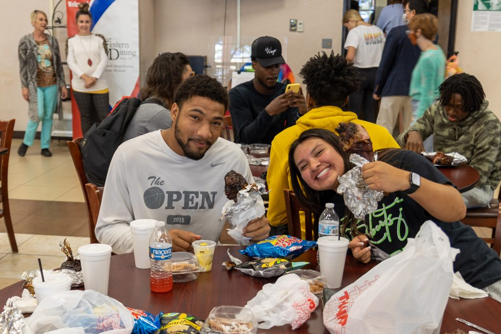 SSC students Elijah Durham, of El Reno, and Uriah McPerryman, of Wetumka, enjoy an assortment of fair food during the event.