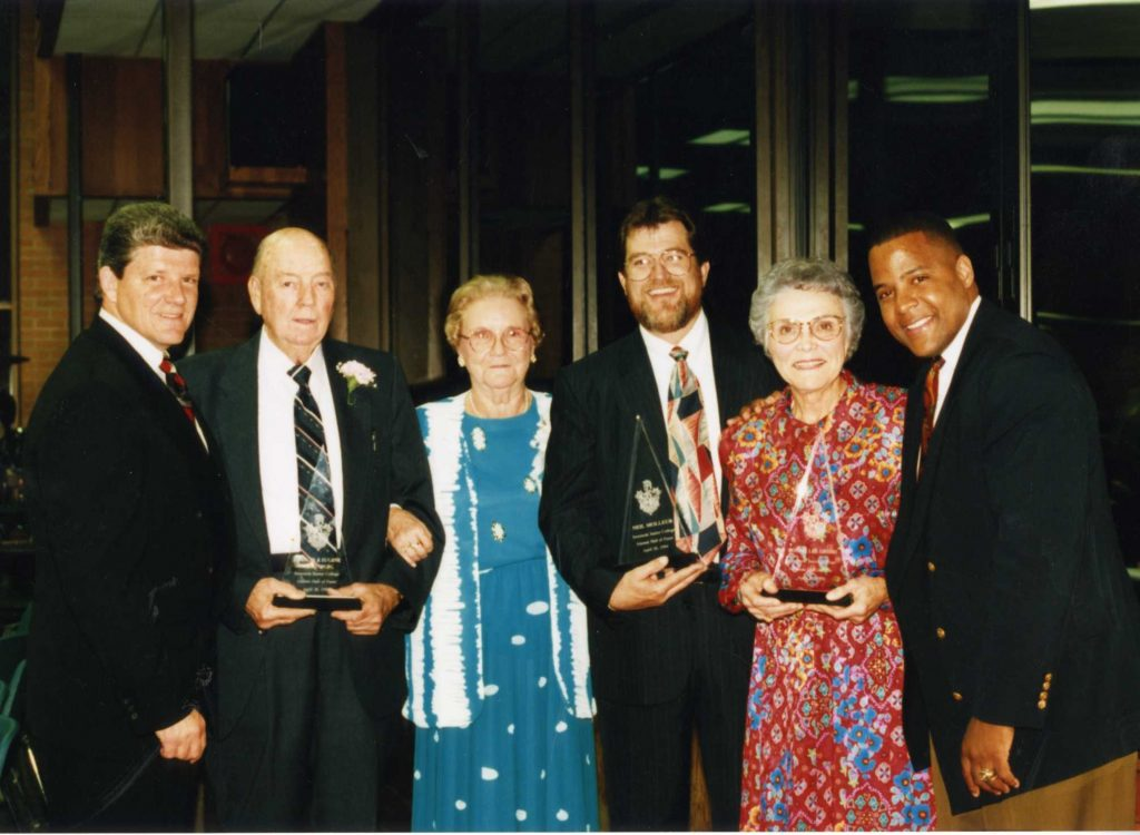 Pictured left to right with Dr. Cook, are: long-time Varnum School Superintendent Eugene Warrenburg; retired SJC Reading Instructor Frances Warrenburg; former Wilson Elementary School Principal Bonnie Lee Grisso; former Seminole civic leader and business owner Neil Molleur; and former Trojan basketball player and NAIA National Championship Coach at Oklahoma City University Win Case.