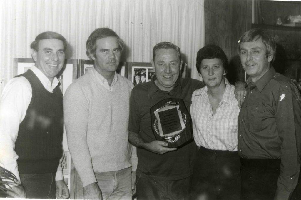 """Leaders of Seminole """"Junior"""" College athletic programs pose with the College's first President Elmer Tanner (center). Pictured from left to right, are long-time Athletic Director Dr. Thurman Edwards, Trojan Baseball Coach Lloyd Simmons, Belles Basketball Coach Dixie Woodall and Trojan Basketball Coach Jim Kerwin. Simmons, Woodall and Kerwin established many of the College's records for wins, championships and producing outstanding athletes during the """"golden age"""" of men's and women's sports in Oklahoma two-year colleges"""