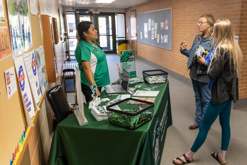 Patsy Spottedbird (left), a representative from Northeastern State University discusses the transfer process with Sierra Josselyn (center), of Seminole, and Ashlyn Tait (right), of Chanute, Kansas.