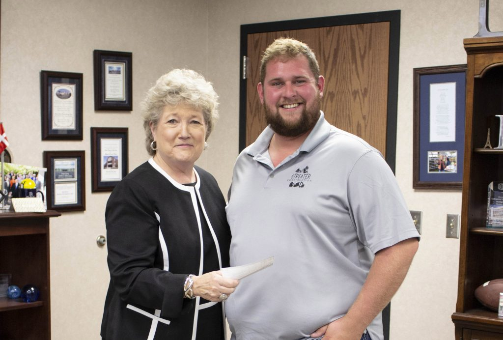 Seminole State College President Lana Reynolds (left) thanks Brandon Streater (right), owner of Streater Construction, for a donation to the SSC Educational Foundation