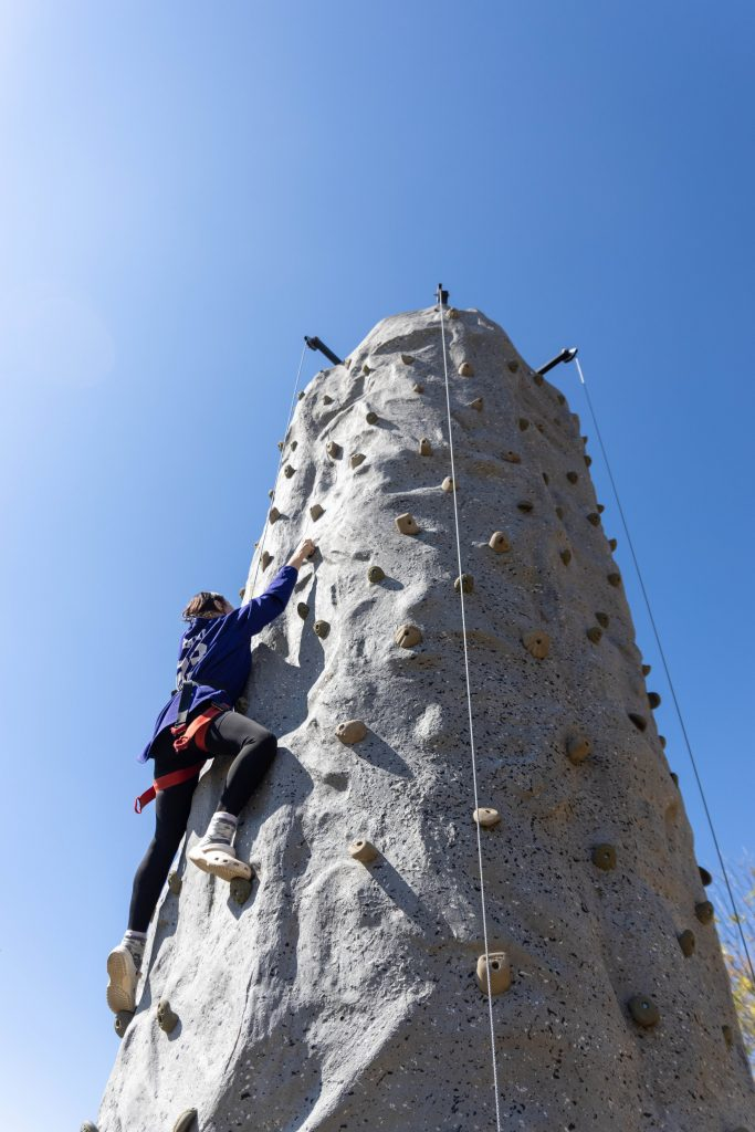 ock Wall  Caption: SSC student Kinnady Grabill, of Anadarko, climbs a rock wall at the Career and Resource Fair on Oct. 6. The rock wall was set up by the Army National Guard