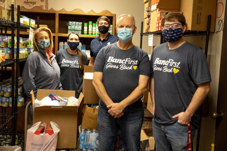 Volunteers stock food pantry