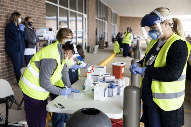 Nurses prepare to administer flu shots.