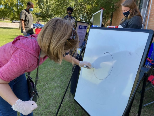 Student draws at Pictionary event.