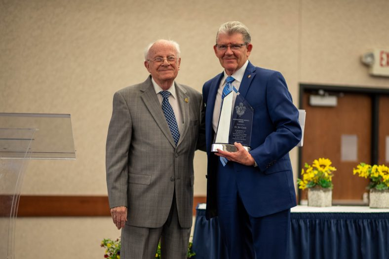 Former SSC Regent Melvin Moran (left) presented the Distinguished Service Award to former SSC President Dr. Jim Cook (right) at the banquet.